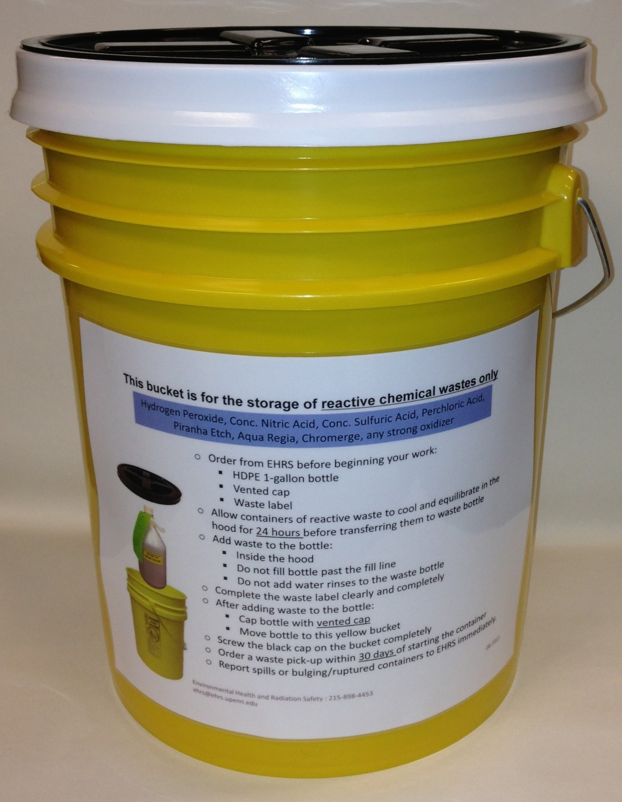 Yellow 5-gallon plastic bucket with black screw top lid and instructions sign affixed to side