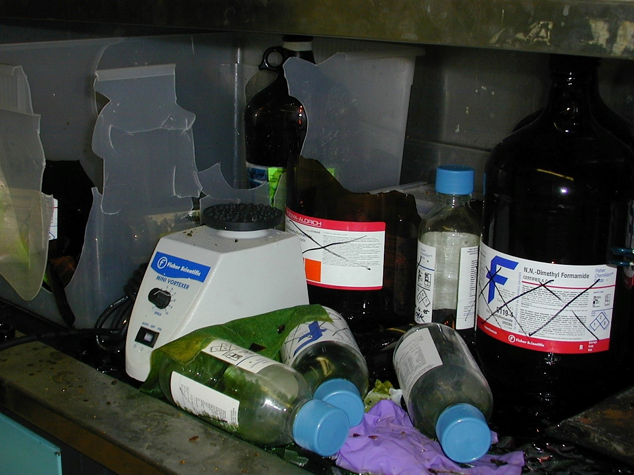 Aftermath of ruptured glass piranha bottle in fume hood