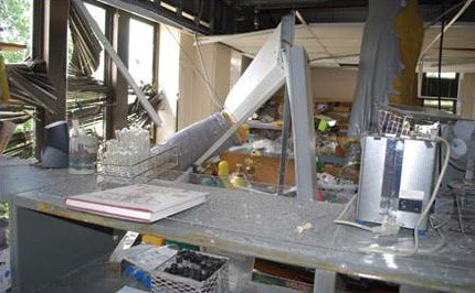 The aftermath of an explosion in a lab.  Debris and damaged structure.